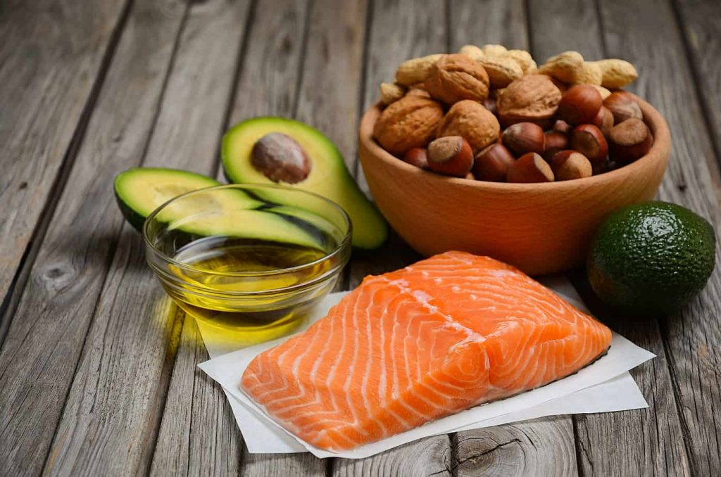 Healthy fats including avocado and salmon