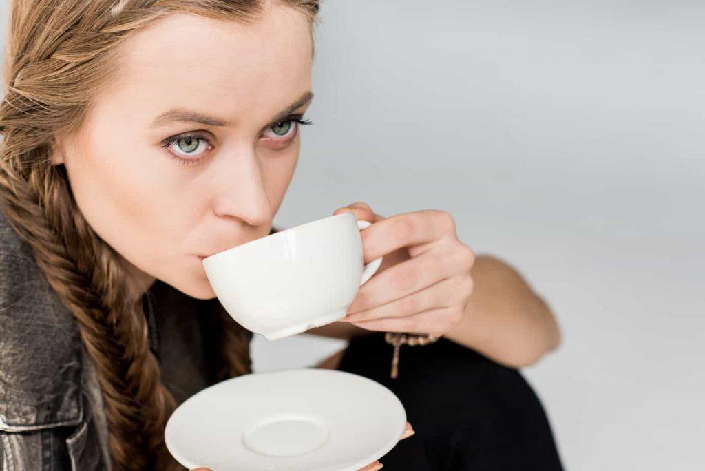 Woman drinking tea.
